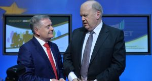 Minister for Finance Michael Noonan (right) and Minister for Public Expenditure and Reform Brendan Howlin  pictured at a press briefing on Budget 2016 on Tuesday evening at Government Buildings. . Photograph: Alan Betson / The Irish Times