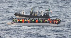 A rib from the Irish Naval Service ship LÉ Samuel Beckett is seen rescuing more than 100 people, including two children, off the Libyan coast on Thursday morning. Photograph: Defence Forces