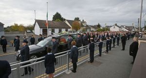 The funeral cortege of Garda Tony Golden passes Blackrock Garda station on its way to St Oliver Plunkett Church, Blackrock in Co Louth. Photograph: Niall Carson/PA Wire