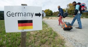 Refugees from Syria near the Austrian-German border. German official attitudes also owe a good deal to enlightened self-interest. Photograph: EPA/Armin Weigel