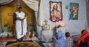 Calais camp: an Orthodox service for Ethiopian and Eritrean worshippers. Photograph: Rob Stothard/Getty