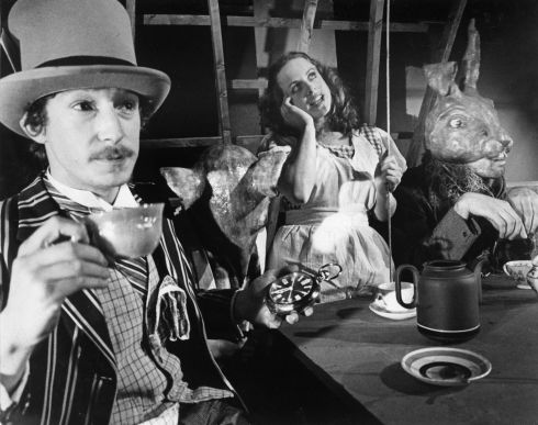 Guy Carleton, Lisa Cooke and Liam Halligan in Alice in Wonderland by Lewis Carroll, 1979, Photograph by  Fergus Bourke.