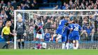 Chelsea players celebrate Diego Costa's opening goal in their 2-0 win over Aston Villa. Photograph: Reuters