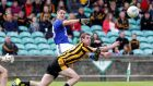 Naomh Conaill's Brendan McDyer gets his shot away despite the effort of Caolan Ward of St Eunan's Photo: Donna McBride/Inpho