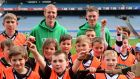 Former Kilkenny hurler Henry Shefflin and Austin Gleeson of Waterford with children from Patrick's GAA, Killarney, at Croke Park as part of the 'Centra's Live Well initiative' skills session. Photograph: Sportsfile.