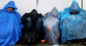 Migrants rest on the ground as they wait to enter Slovenia from Trnovec, Croatia on Monday. Photograph: Reuters