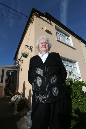 SATELLITE ROW: Pensioner Ann 'Peg' Rudd outside her home in Terenure at the place her satellite dish used to be located after she was ordered to remove it by Dublin City Council. Photograph: Colin Keegan/Collins Dublin.