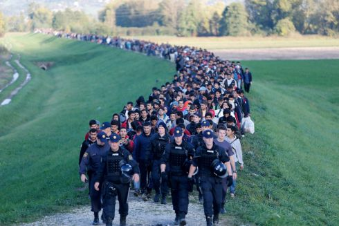 MIGRANT CRISIS: People are escorted by police on the outskirts of Brezice, Slovenia. Slovenia's interior ministry raised the possibility on Tuesday of setting up physical barriers along its southeastern border if the numbers of migrants and refugees increased. Photograph: Srdjan Zivulovic/Reuters