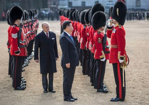 STATE VISIT: China's president Xi Jinping and Britain's Prince Philip review an honour guard during his official welcoming ceremony in London. Photograph: Richard Pohle/Reuters