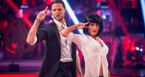 Jay McGuiness and his professional partner Aliona Vilani perform a Pulp Fiction-themed jive. Photograph: BBC / Guy Levy
