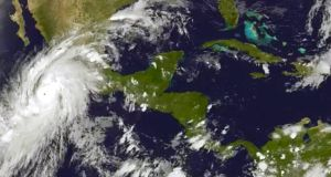 A handout satellite picture released by the US National Oceanic and Atmospheric Administration  on October 22nd shows Hurricane Patricia as it approaches the coastline of Mexico from the eastern Pacific. Photograph: EPA