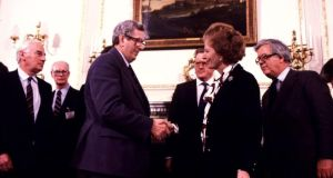 Garret FitzGerald and  Margaret Thatcher shake hands after signing the Good Friday agreement in 1985. Photograph: Photocall Ireland