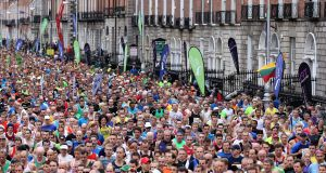 Some of the crowd champing at the bit as the Dublin City Marathon 2014  gets under way last October. File photograph: Ryan Byrne/Inpho