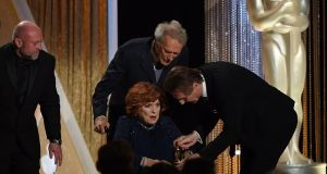 Actor Maureen OHara (centre) with Clint Eastwood (centre, top) and Liam Neeson (right) as she receives an Honorary Award by the Board of Governors of the Academy of Motion Picture Arts and Sciences during the Governors Awards Ceremony in  2014. Photograph: MARK RALSTON/AFP/Getty Images)