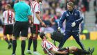 Sunderland captain John O'Shea limped off during the first half of the Tyne-Wear derby. Photograph: Getty