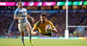 Australia's Adam Ashley-Cooper scores his second try during the Rugby World Cup semi-final against Argentina at Twickenham. Photograph:  David Davies/PA