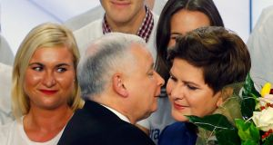 The leader of Poland's main opposition party Law and Justice (PiS), Jaroslaw Kaczynski, kisses the party's candidate for prime minister Beata Szydlo after the exit poll results were  announced in Warsaw on Sunday night. Pawel Kopczynski/Reuters