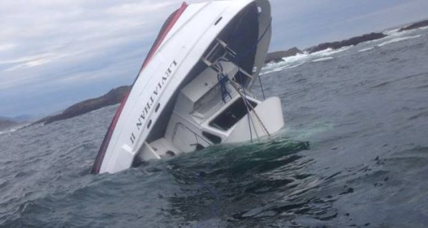 The tour boat which had 27 passengers on board is seen sinking off the coast of British Columbia, Canada. Photograph: Albert Titian/Facebook
