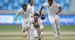 Pakistan spinner Yasir Shah  celebrates with team-mates Sarfraz Ahmed and Wahab Riaz after dismissing England's Adil Rashid  to win the second Test  at Dubai Cricket Stadium. Photograph: Gareth Copley/Getty Images