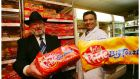 Chief Rabbi Dr Yaakov Pearlman and Ralph Jacob at the Kosher Corner with a loaf of Irish Pride, certified Kosher at Super Valu Churchtown, Dublin. Photograph: Bryan O'Brien/The Irish Times
