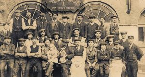 A group of workers at the Beamish and Crawford brewery in 1913