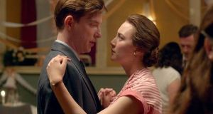 Dómhnaill  Gleeson and Saoirse Ronan in the film Brooklyn