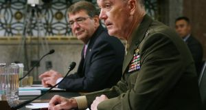 US defence secretary Ashton Carter and Joint Chiefs of Staff chairman Gen Joseph Dunford testify before the Senate Armed Services Committee on Capitol Hill about the US military strategy in the Middle East. Photograph: Chip Somodevilla/Getty Images