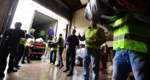 Volunteers loading a container for Human Appeal Ireland. The aid is going into the region around Damascus where there has been a  large amount of displacement. Photograph: Cyril Byrne