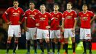 Manchester United players during the penalty shootout. Photograph: Darren Staples/Reuters