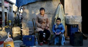 Migrant worker Huang Feng (52) with her grandson. She welcomed the decision to drop the one-child policy. Photograph: Kim Kyung-Hoon/Reuters