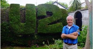 Colm Hughes with his U2 hedge in Malahide. Photograph: Bryan O'Brien