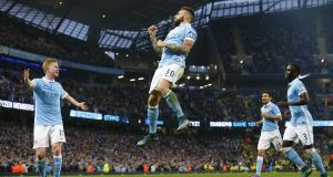 Manchester City's Nicolas Otamendi celebrates after scoring the opening goal of the Premier League match against  Norwich City at The Etihad Stadium. Photograph: Lindsey Parnaby/AFP