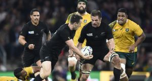 New Zealand's fullback Ben Smith  passes to his captain Richie McCaw during World Cup final against Australia at Twickenham. Photograph: Franck Fife/AFP/Getty Images