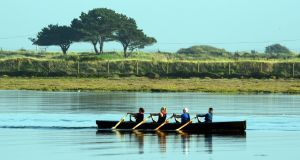 A currach near the Bull Wall bridge in Clontarf on Sunday during the unseasonably warm weather. Photograph: Cyril Byrne/The Irish Times