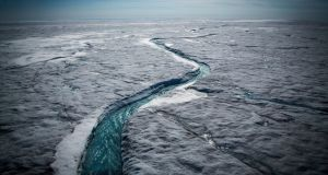 Meltwater flows along the Greenland ice sheet, one of the biggest and fastest-melting chunks of ice on Earth. Photograph: Josh Haner/the New York Times