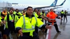 Airport workers welcome All Blacks home with haka