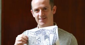 "Peter Connolly, occupational therapist at St John of God Hospital, Dublin, with Zentangle patterns: 'One client said to me: ""I've been waiting for something like this all my life.""' Photographs: Nick Bradshaw"