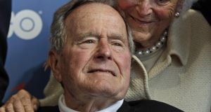George H W Bush pictured with his wife, former first lady Barbara Bush, in 2012.
