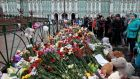People gathered to lay flowers in memory of the plane crash victims at Dvortsovaya (Palace) Square in St Petersburg, Russia. Photograph: Ivan Sekretarev/AP