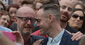 Emotional moment: a couple at Dublin Castle when the referendum victory was announced. Photograph: Charles McQuillan/Getty