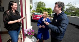 Doorstep challenge: Yes Equality canvassers Seamus Carey and Regina Bushell talk to Jennifer O'Meara, an Athlone voter. Photograph: James Flynn/APX