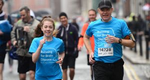 Katie Cooke runs with Dr Colin Doherty at the start of the SSE Airtricity Dublin Marathon on October 26th. Photograph: Dara Mac Dónaill