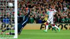 Shane Long scores the winner for Ireland against world champions Germany. Photograph: Donall Farmer/Inpho