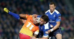 Leinster's Dominic Ryan is tackled by Michael Tagicakibau of Scarlets during the Guinness Pro 12 game at the RDS. Photograph: Ryan Byrne/Inpho