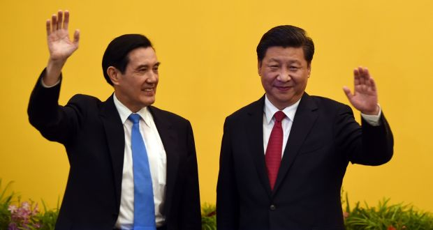 Chinese President Xi Jinping (right) and Taiwan President Ma Ying-jeou wave to journalists before their meeting at Shangrila hotel in Singapore. Photograph: Getty