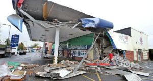 The scene of destruction after an ATM was ripped from a petrol station near Newry, Co Down. Photograph: Alan Lewis