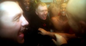 Joint Salford City owner Paul Scholes celebrates victory in the changing room after the FA Cup first round win over Notts County at Moor Lane. Photograph: Chris Brunskill/Getty Images