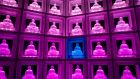 A glass Buddha altar at the Ruriden columbarium in Tokyo, Japan. Operated by the Koukokuji Buddhist Temple, it houses 2,046 futuristic altars. A smartcard allows the owner to access the building and lights up the corresponding statue. Photograph: Chris McGrath/Getty Images