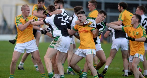 Killarney Legion and South Kerry players get to grips with each others following the final whistle