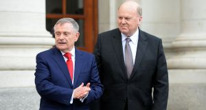 Brendan Howlin and Michael Noonan present the budget last month: the regressive nature of their tax changes give the greatest benefit to higher earners, according to Tasc's findings. Photograph: Eric Luke.
